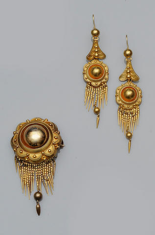 A mid Victorian brooch and earrings suite (2)