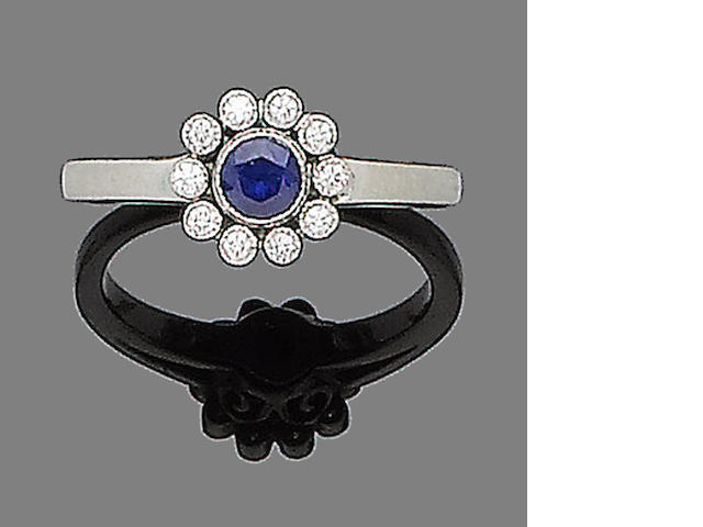 A sapphire and diamond cluster ring, by Tiffany & Co