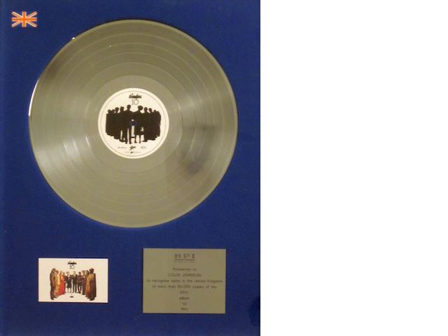 The Stranglers: a 'Silver' sales award for the album '10', 1990,