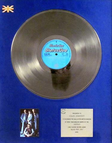 Staus Quo: a 'Silver' sales award for the album 'Blue For You',  1976,