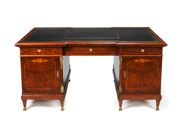 A Directoire style amboyna and gilt-metal mounted partner's pedestal desk
