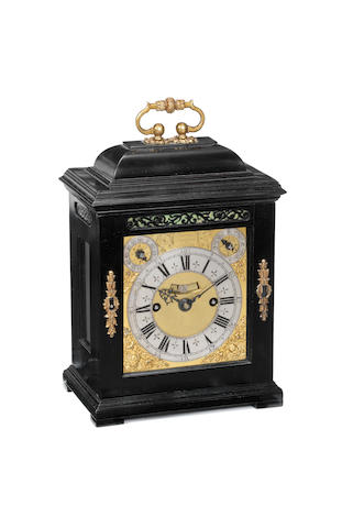 An exceptional miniature ebony striking bracket clock Thomas Tompion, London, number 215.  The dial and movement circa 1693, the case later.