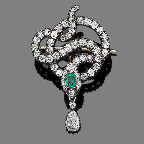 An emerald, ruby and diamond brooch,