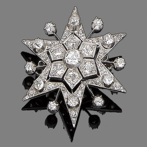 A diamond star brooch/pendant,