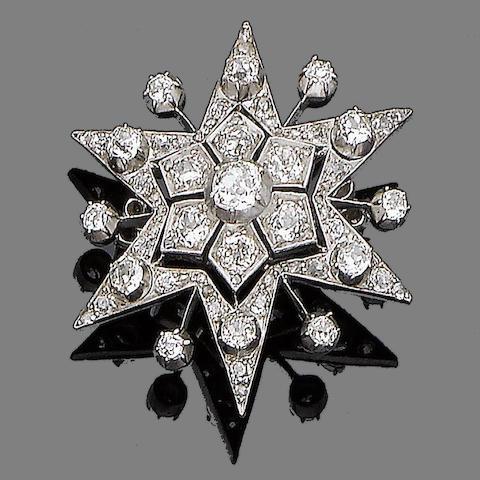 A diamond star brooch/pendant,
