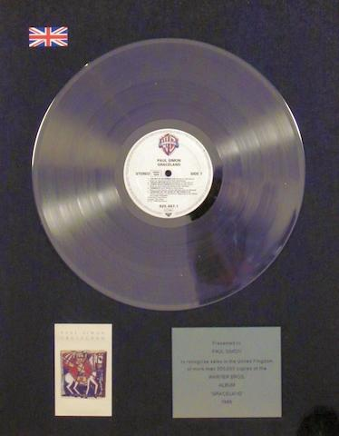 A 'Platinum' sales award for the album 'Graceland' by Paul Simon, 1986,