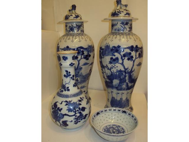 A pair of Chinese blue and white baluster vases and covers