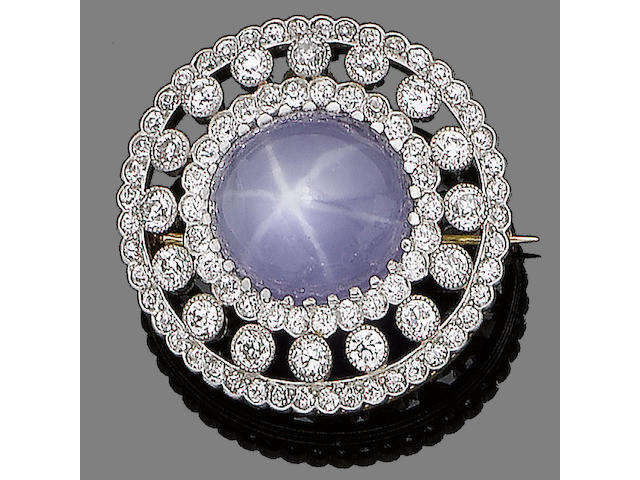 A star sapphire and diamond brooch/pendant,