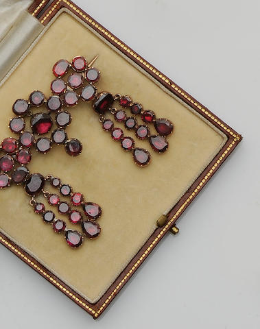 A closed back garnet brooch