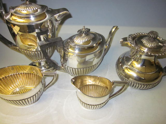 An Edwardian four piece matching tea and coffee service, by Walker & Hall, Sheffield, 1908,  (5)