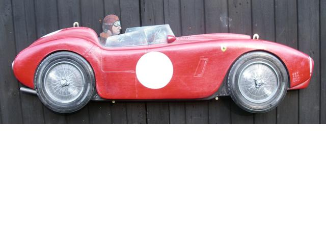 A hand-painted wooden profile of a Ferrari sports car,