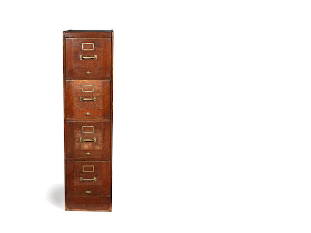 An early 20th century oak filing cabinet