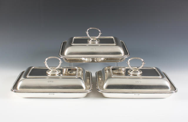 A set of three late Victorian silver entreé dishes and covers By Mappin & Webb, Sheffield, 1900,