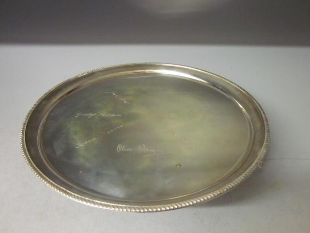 A circular salver, by Elkington and Co., Birmingham 1934,