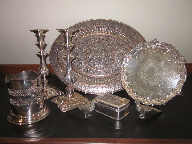 A pair of Georgian style Sheffield plate candlesticks together with eleven other plated items late 19th century