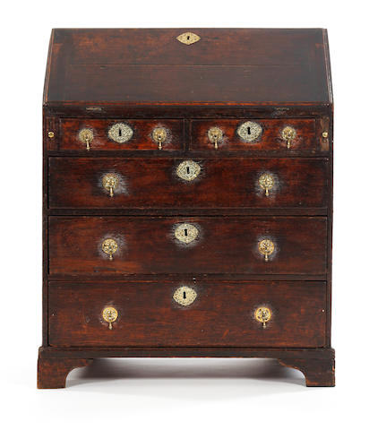 An early 18th century small oak bureau