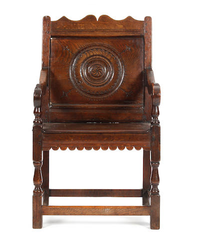 An oak panel back open armchair 17th century and later