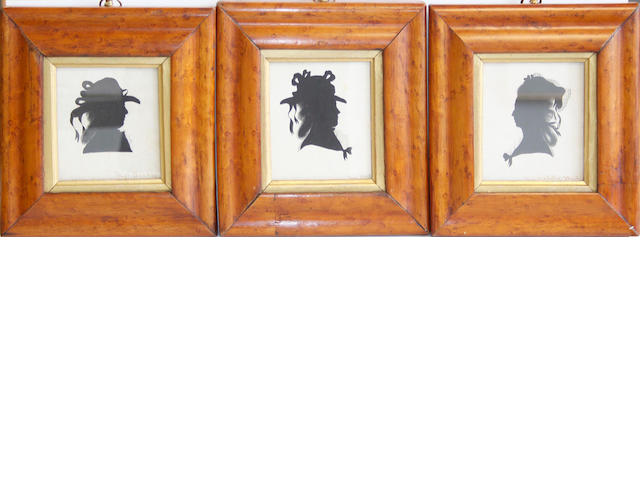English School, circa 1785 A set of three silhouette of Ladies, with hair in banging chignons and dressed with hats and ribbons