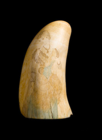 A late 19th century decorated whale's tooth, 5.2ins. (13cm)long.