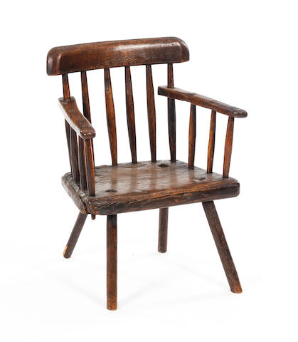 An early 19th century ash and elm primitive armchair Possibly West Country