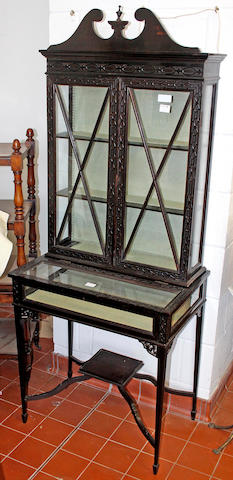 An Edwardian ebonised display cabinet, in the Chinese Chippendale taste,