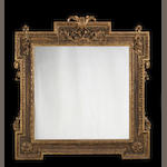A Victorian carved giltwood mirror in the manner of William Kent