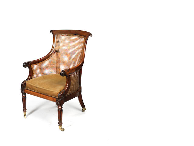 A Regency carved rosewood bergere in the manner of Gillows