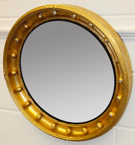 A Regency style gilt convex mirror
