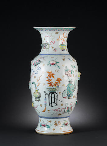 A famile rose enamelled moulded vase with auspicious objects