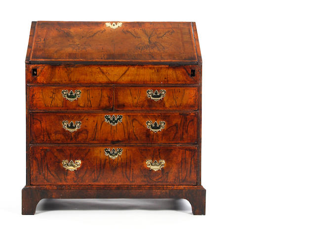 George II figured walnut and featherbanded bureau Circa 1740