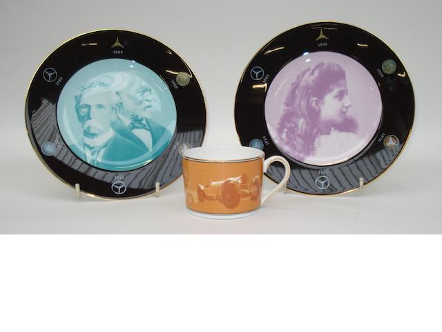 Mercedes-Benz commemorative cup, saucer and a pair of bone china plates, by Wedgwood,