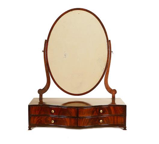 A George III mahogany oversize toilet mirror