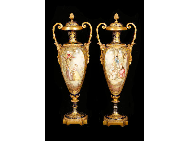 A large pair of late 19th century Sèvres style and gilt metal mounted vases and covers