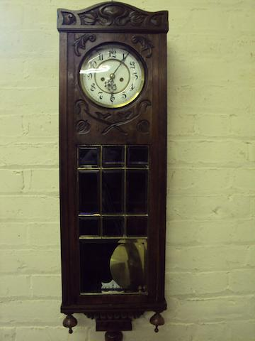 A 19th century stained Vienna-style wall clock