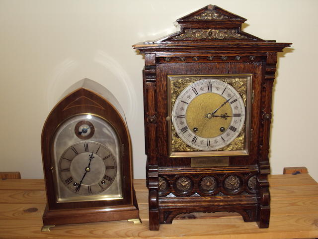A mahogany cased bracket clock and an oak bracket clock of Arts & Crafts style