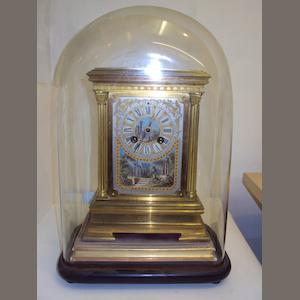 A French gilt-metal mantel clock and glass dome