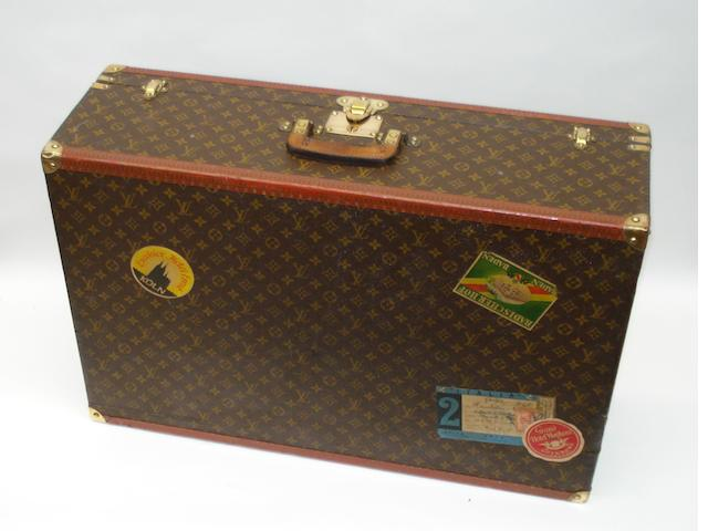 A large Louis Vuitton suitcase with travel labels, circa 1940,