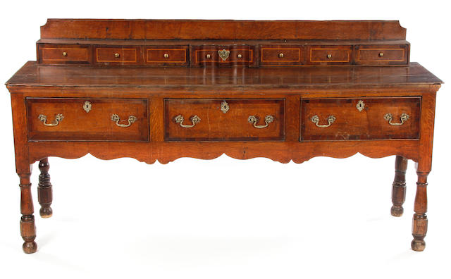 A George II and later oak, fruitwood and boxwood line inlaid low dresser