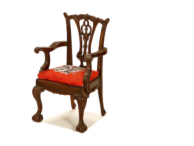 An Edwardian walnut child's armchair in the Chippendale style