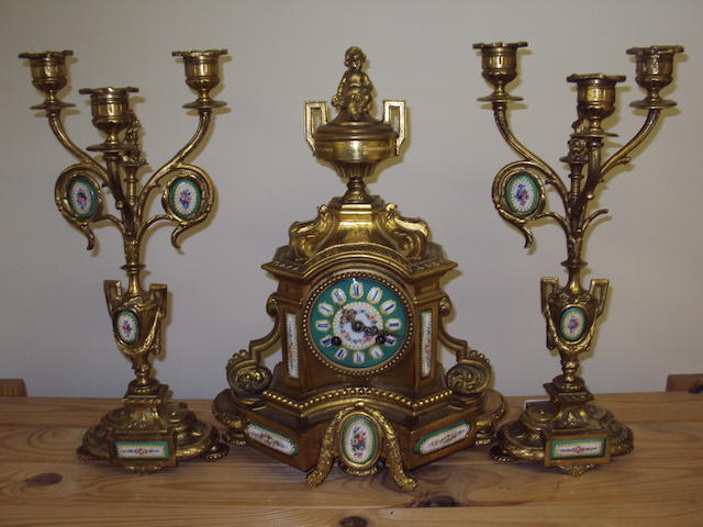 A late 19th century gilt-metal clock garniture with twin train movement