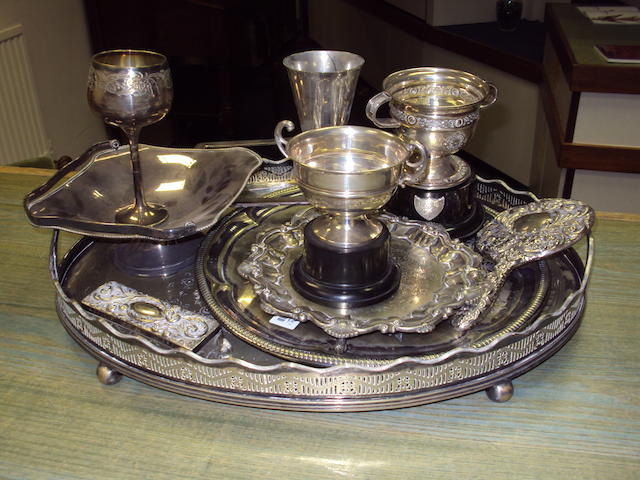 2 silver trophy cups, hand mirror, pin jar, photo frame (part only) and a quantity of electro-plate