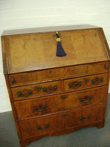 "A George I walnut bureau, crossbanded and inlaid with feather lines, stepped interior with well and two short and two long drawers, 208cm wide x 48cm deep x 94cm high, (82"" wide x 18.5"" deep x 37"" high)"