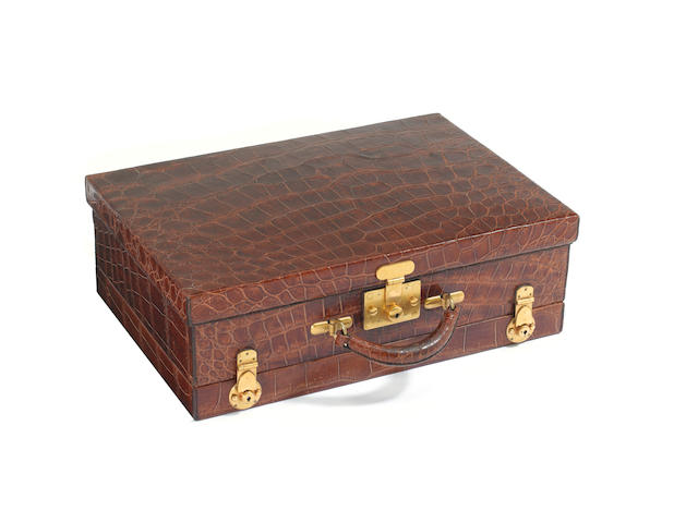 A crocodile dressing case