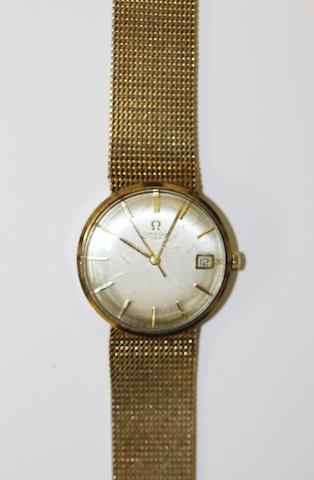 Omega: A gentleman's 9ct gold automatic calendar bracelet watch
