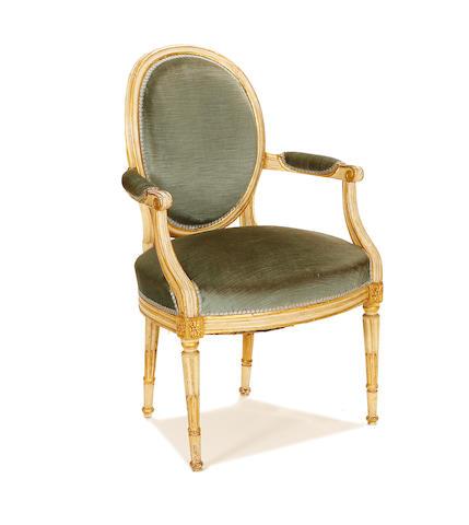 A Louis XVI painted and parcel gilt fauteuil