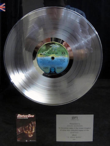 Status Quo: a 'Platinum' sales award for the album '12 Gold Bars', 1981,