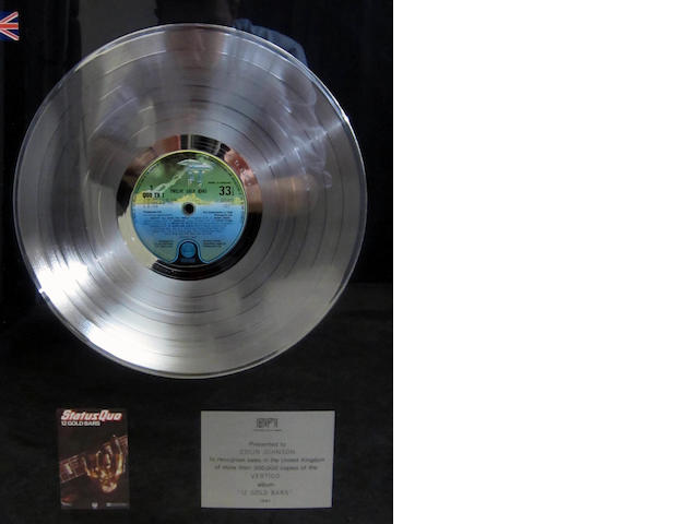 Status Quo: a 'Platinum' sales award for the album '12 Gold Bars'