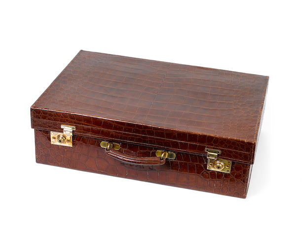 An early 20th century brown crocodile leather travelling case,