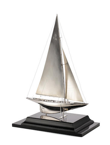 A silver model of the 12 metre racing yacht Miquette 1934, by Benzie of Cowes, deck with incuse stamp BENZIE COWES, with lion passant and town marks only, London, no date letter,