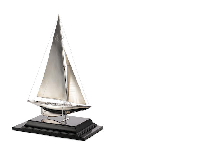 A silver model of the 12 metre racing yacht Miquette 1934  by Benzie of Cowes, London, no date latter,